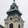 The steeple (tower) of the baroque Roman Catholic Assumption of the Virgin Mary Parish Church - Szentgotthárd, Maďarsko