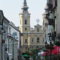"""The Minorite Church of Miskolc on the Hősök tere (""""Heroes' Square""""), viewed from the pedestrian street - Miskolc, Ungheria"""