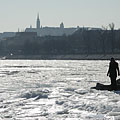 Ice world in January by River Danube (in the distance the Buda Castle Quarter with the Matthias Church can be seen) - Budapeszt, Węgry