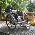 Metal sculpture of Gyula Krúdy Hungarian writer, sitting on a carriage - Siófok, Ungarn