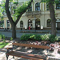 A bench in the park with the Sas Pharmacy in the background - Békéscsaba, Ungari