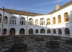 The inner courtyard of the old County Hall, including the ruins of a mediaeval church, the foundations of the former walls - Szekszárd, Ungarn