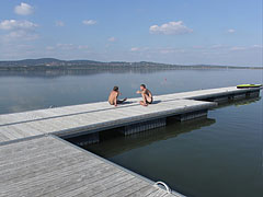 Autumn calm on the bathing platform in the Velence Lake, there's no wind just warm sunshine - Agárd, Hungary