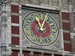The clock on the tower of the Centraal Station (Central Train Station) - Amsterdam, Netherlands