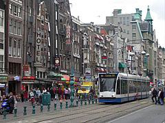 "Street view with a tram, viewed from the former commodity market hall (""Beurs van Berlage"") - Amsterdam, Netherlands"