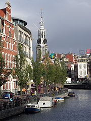 A Singel Canal (Singelgracht) with the Munt tower (Munttoren) - Amsterdam, Netherlands