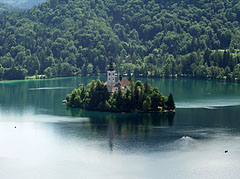 Tiny island with a church in the middle of the beautiful deep green Bled Lake, viewed from the castle - Bled, Slovenia