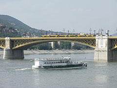"The Margaret Bridge (""Margit híd"") and a sightseeing boat (converted from an old steamboat) on River Danube in front of it - Budapest, Hungary"