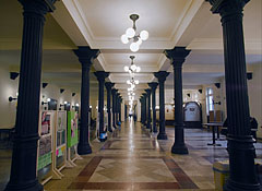The broad corridor (hallway) on the ground floor, decorated with colonnades - Budapest, Hungary