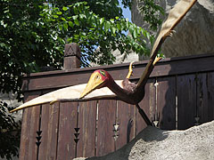 A pterosaur (ancient flying reptile) above the entrance of the Magical Hill - Budapest, Hungary