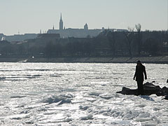 Ice world in January by River Danube (in the distance the Buda Castle Quarter with the Matthias Church can be seen) - Budapest, Hungary