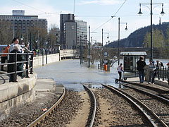 The Danube River is boycotting the public transport on the Pest riverside as well, the tracks of the tram line 2 at the Chain Bridge is under the water, the tram's tunnel under the bridge is almost full of water - Budapest, Hungary
