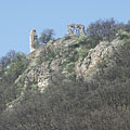The ruins of the medieval castle on the cliff, viewed from the edge of the village - Csővár, Hungary