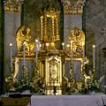 The gold-plated main altar with angel sculptures in the Roman Catholic St. Michael's Church - Dunakeszi, Hungary