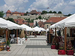 Wine festival tents in the main square, and the Castle of Eger in the distance - Eger, Hungary