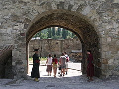 The arched Varkoch Gate (also known as the Varkocs Bastion) with authentic guard of honor, viewed from the inner castle - Eger, Hungary