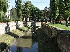 In the downtown the Eger Stream is flowing between stone walls - Eger, Hungary