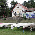 Canoes on the riverbank at the Széchenyi Csárda restaurant in Alsógöd - Göd, Hungary