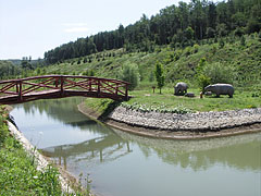 Small lake with wooden bridge and prehistoric rhinos - Ipolytarnóc, Hungary