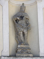 Statue of St. Ladislas of Hungary with an axe in his hand in a wall niche on the Roman Catholic Great Church - Jászberény, Hungary