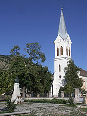 The Lajos Kossuth statue and the monumental Reformed church in the main square - Nagyharsány, Hungary