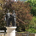 Statue of Hungary's first royal couple (King St. Stephen I. and Queen Gisela), and far away on the top of the hill it is the Upper Castle of Visegrád - Nagymaros, Hungary