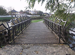 Wooden footbridge with iron railing in the park - Nyírbátor, Hungary