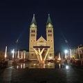The now completely pedestrian-only main square of Nyíregyháza in the evening, looking towards the illuminated twin-towered Roman Catholic church - Nyíregyháza, Hungary