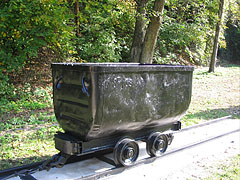 A minecart (also known as mining wagon, mine car, tippler, chaldron wagon or quarry tub) in the mining exhibition near the old smelter of Újmassa - Ómassa, Hungary