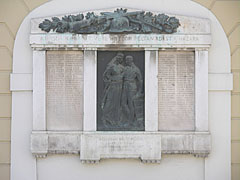 World War I memorial with a bronze plaque on the wall of the Fire Tower - Szécsény, Hungary