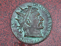 "The coin imitating portrait of Diocletianus roman emperor, on the sculpture called ""Emperor's stone"" in the main square - Szombathely, Hungary"