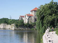Jogging in the morning by the Lake Öreg on the promenade beside the Tata Castle - Tata, Hungary