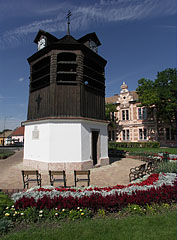 Belfry or Clock Tower of Tata, and behind it some distance away it is the Vaszary János Primary School - Tata, Hungary