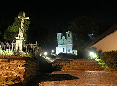 Stairs to the Benedictine Abbey and a crucifix in the old village at night, viewed from the main street - Tihany, Hungary