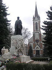 Statue of the 19th-century Hungarian politician László Csányi in front of the neo-gothic style Evangelical Lutheran Church - Zalaegerszeg, Hungary