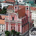 The red-colored twin-towered Franciscan Church, viewed from the castle tower - Ljubljana, Slovenija